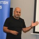 2. Dr. Raj Curwen addressing the audience